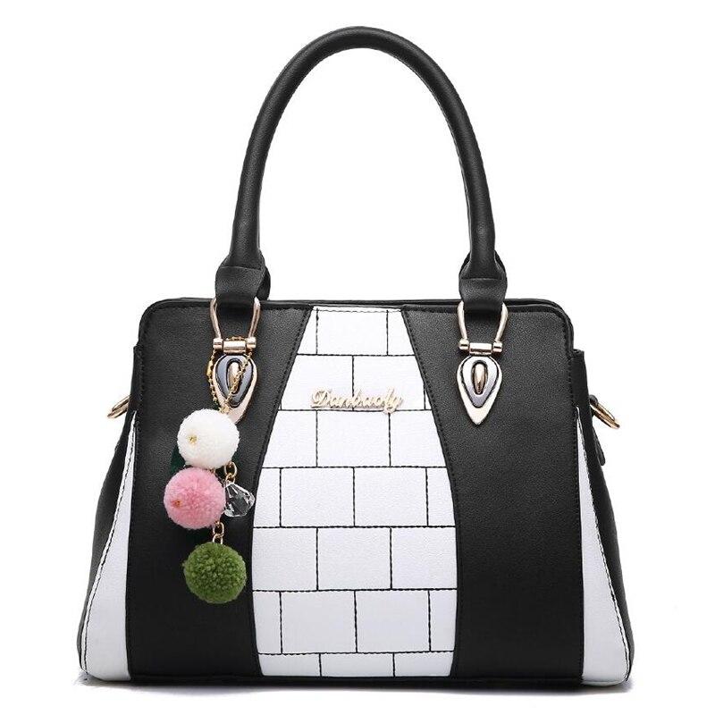 215379343f117 Mode femmes tout nouveau Design sac à main noir et blanc rayure sac fourre  tout femme sacs à bandoulière haute qualité PU cuir sac à main L8 46 dans  ...