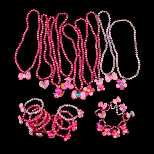 e242bc555b02 € 0.89 16% de DESCUENTO Moda Niña de imitación perlas collar de fresa  pulsera anillos joyería Set niños bebé niños regalo del partido en de en ...