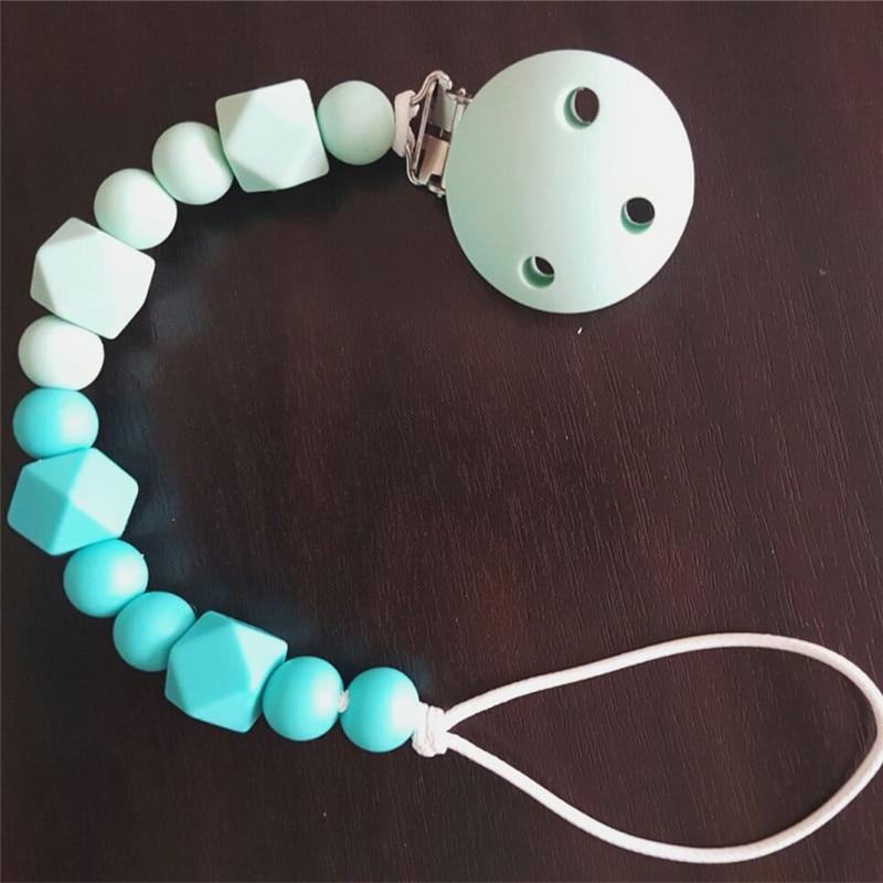 Купить с кэшбэком Chenkai 50pcs Silicone Round Clips DIY Baby Teether Pacifier Dummy Montessori Sensory Jewelry Holder Chain Toy Clips