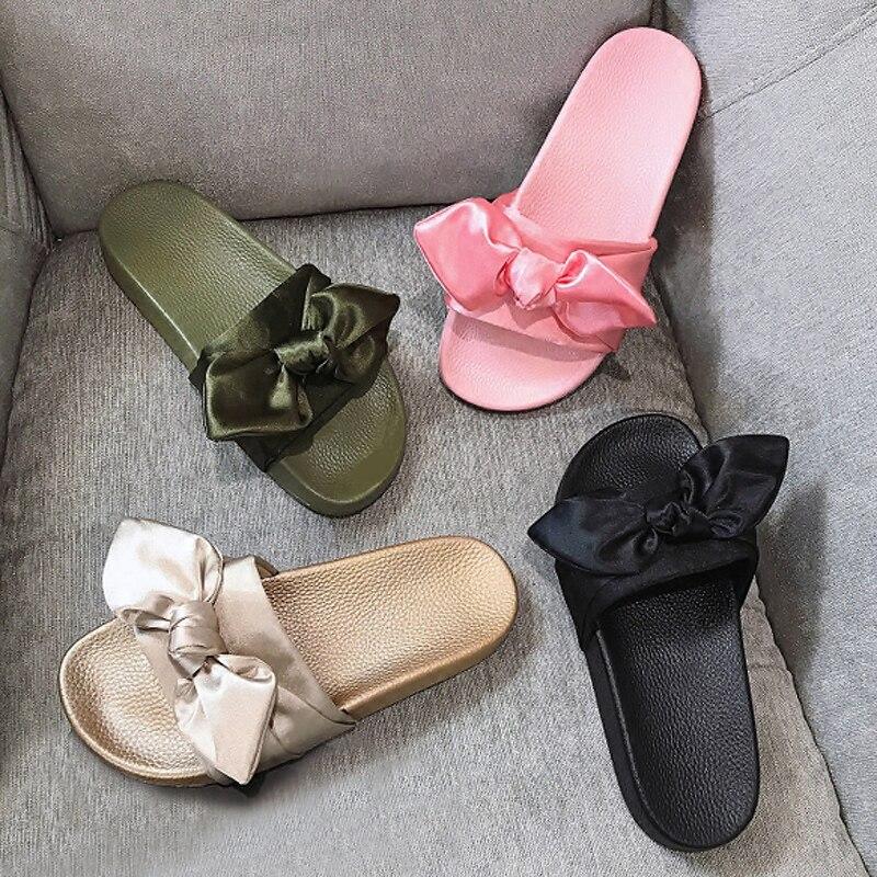 כפכפים נשים שקופיות קשת משי אישה לא נעלי בית פרווה נעלי החוף בקיץ כפכפי נשות עקבים שטוחים סנדלי בוהמה ריהאנה