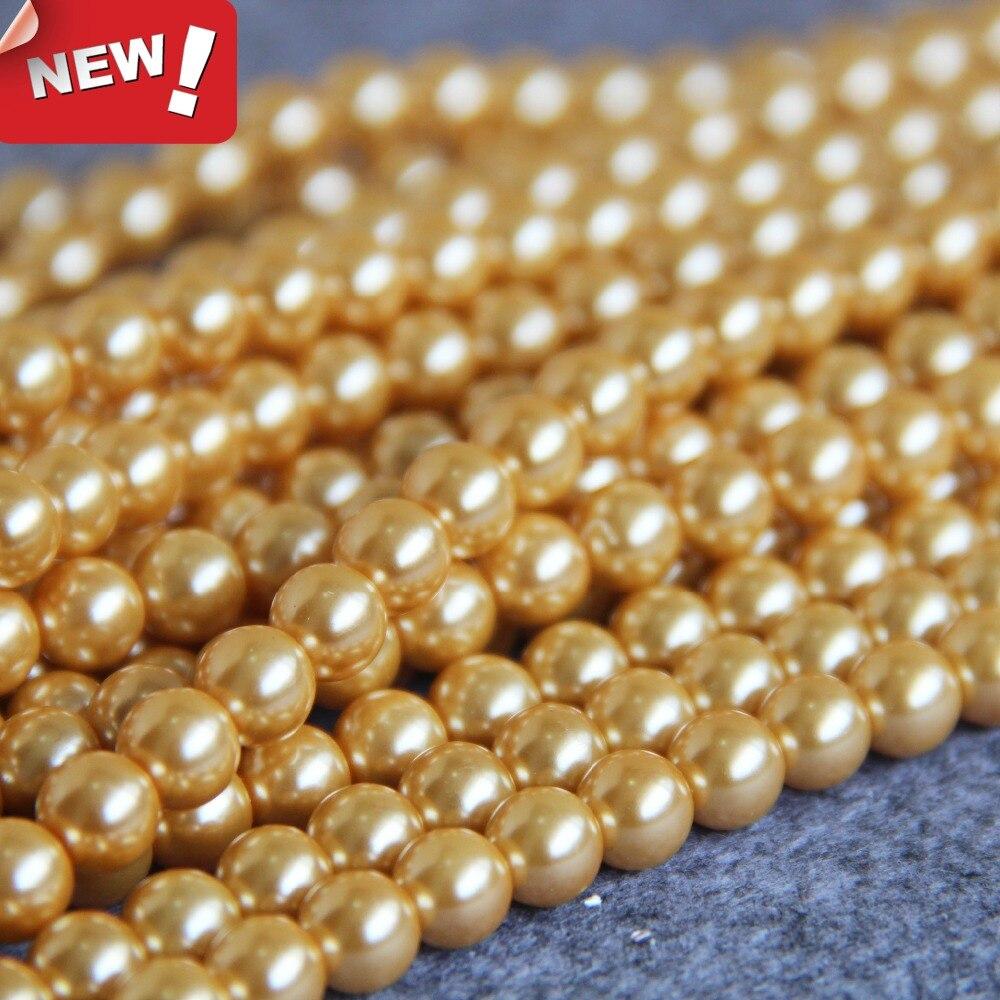 a942508e485fd جديد 8 ملليمتر الذهب-اللون قذيفة اللؤلؤ الخرز صدف DIY هدايا للنساء فتاة  فضفاض الخرز صنع المجوهرات تصميم النساء الفتيات هدية 16 بوصة