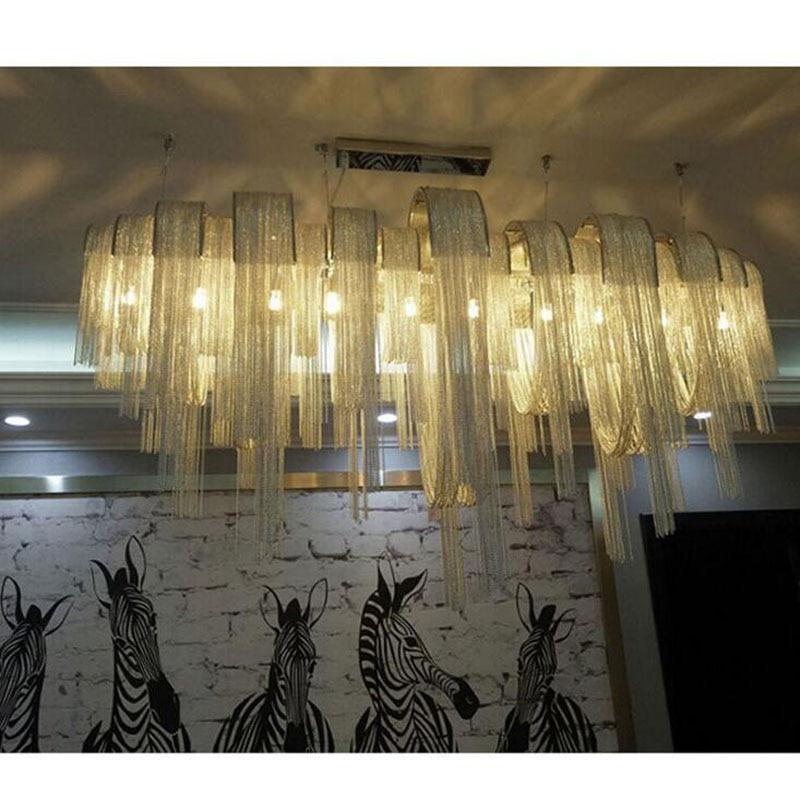 купить Postmodern arched aluminum chain chandelier suspension ring light shadow hotel club living room restaurant tassel chain LED lamp по цене 65889.58 рублей