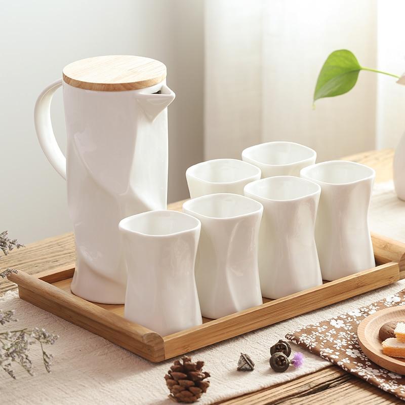 Café moderne fait à la main en céramique blanc thé ensemble quatre tasse à thé avec une théière fleur thé bouilloire Pot Drinkware Teaware conteneur