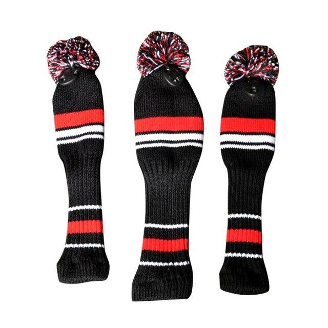 Un conjunto negro rojo blanco lana knit Palos de golf set conductor ...