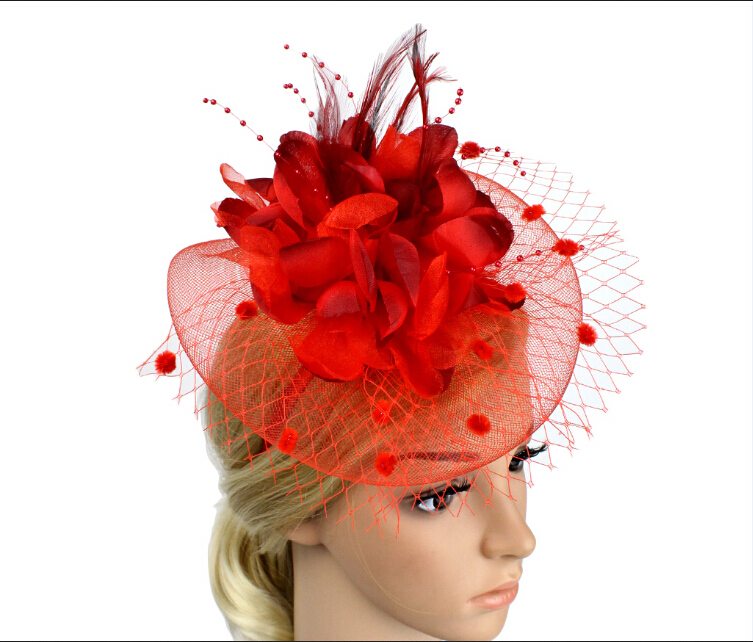HAIR FASCINATOR in blue and red feathers on a clip Weddings Races