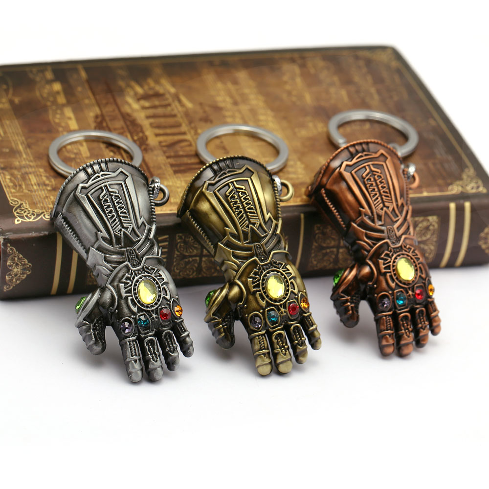 Infinity Gauntlet Keychain with ancient book