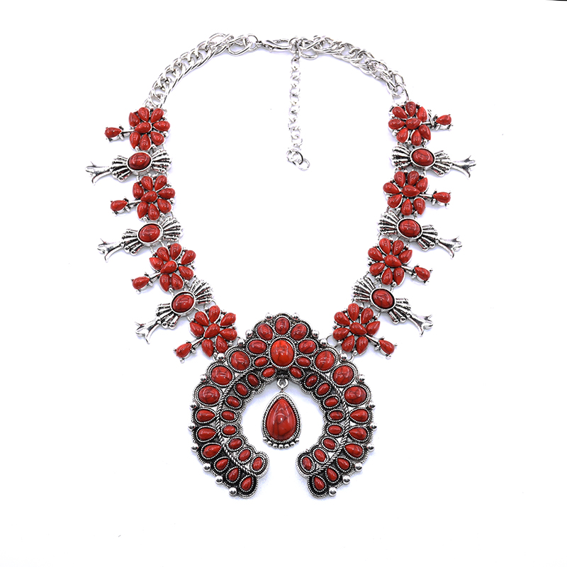 Tribal statement fashion jewellery on a large red pendant fabric choker necklace