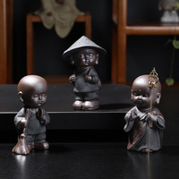 Lovely cute black pottery ceramic buddha statue porcelain home decoration gift kungfu tea pet figurine buddhas statues
