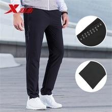Xtep мужские повседневные брюки из натуральной Осенние новые быстросохнущие микро-эластичные спортивные штаны 882329499076