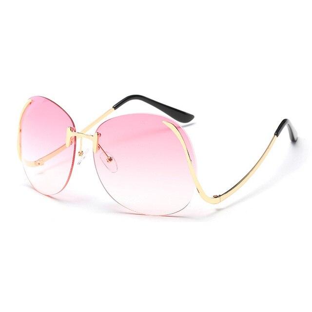 2018 mais recente moda de Metal Mulheres Sem Moldura curva da perna óculos  de sol feminino cacf9038f6