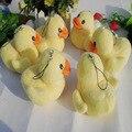 50 unids/lote Mini gigante de luz de goma pato amarillo Hong Kong juguetes de peluche con la cadena colgante pequeño de peluche para cumpleaños