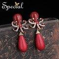 Especial de Moda de Nova Adorável Octups Oscila O Brinco de Ouro-banhado Clipe Auricular de Esmalte Anti-Perfuração Da Orelha Jóias Presentes para mulheres EJ0004