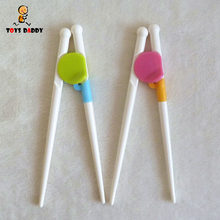 NEW Learning chopsticks children baby smart chopsticks practice Exercise Training chopsticks Baby Feeding Tablewar green pink(China)