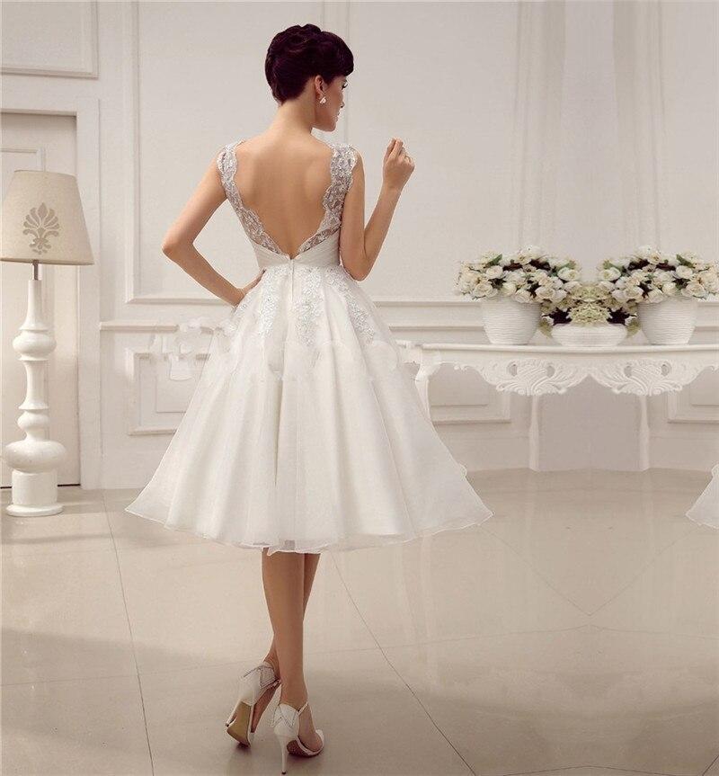 Beaded Short Wedding Dress With Jewel Neck Sequin Tea Length Embroidery  Vestido De Noiva Bridal Gowns Lace Backless Wdding Dress-in Wedding Dresses  from ... 9e02d9026312