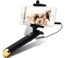Universal de lujo mini selfie stick monopod para iphone samsung android ios cable palo selfie cámara ranura párr