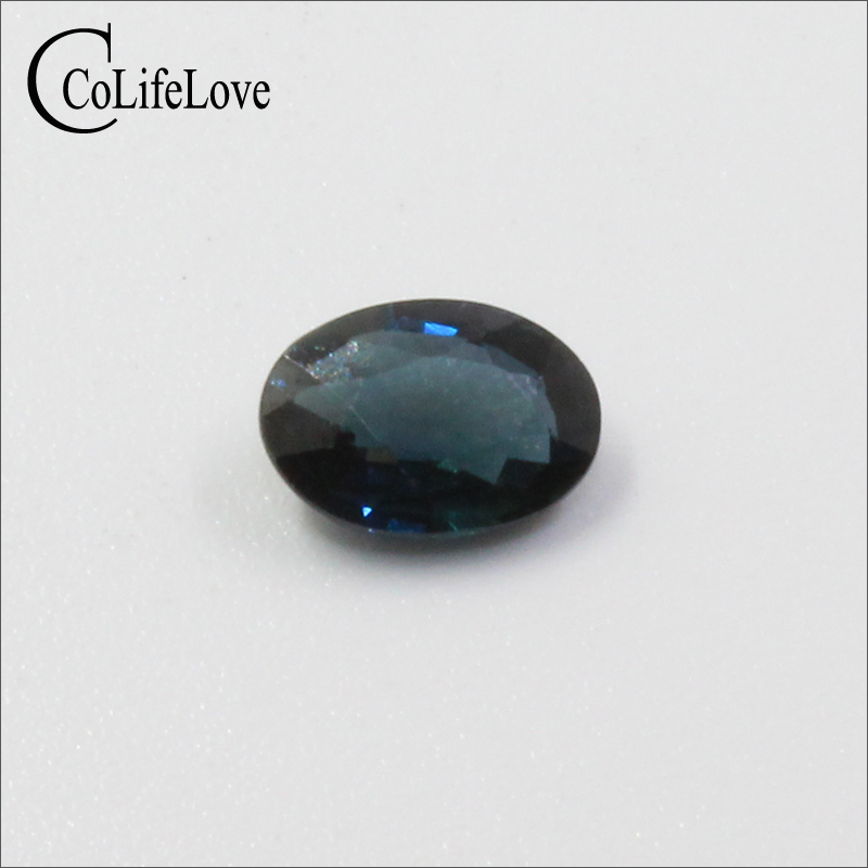 Chinese midnight blue sapphire loose gemstone 0.8 ct 5 mm * 7 mm real natural sappire gemstone for gold jewelry maker