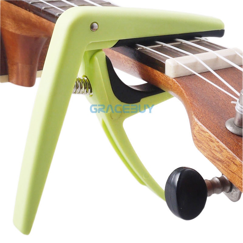cheap nylon green guitar capo key clamp quick change for ukulele acoustic electric guitar for. Black Bedroom Furniture Sets. Home Design Ideas