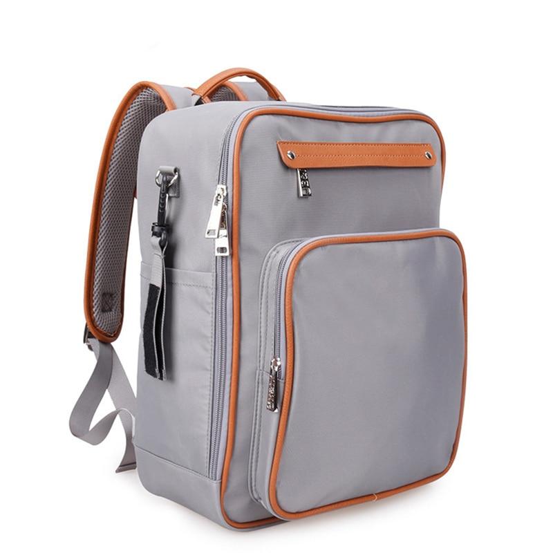 2017 nouveau Style Nappy sac à dos maman sac à couches Portable poussette femmes sac de maternité imperméable en Nylon bébé sac mochila infantil