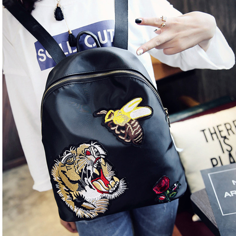 ФОТО Korean version preppy school style Oxford spinning  leather carton  personality embroidered tiger backpack