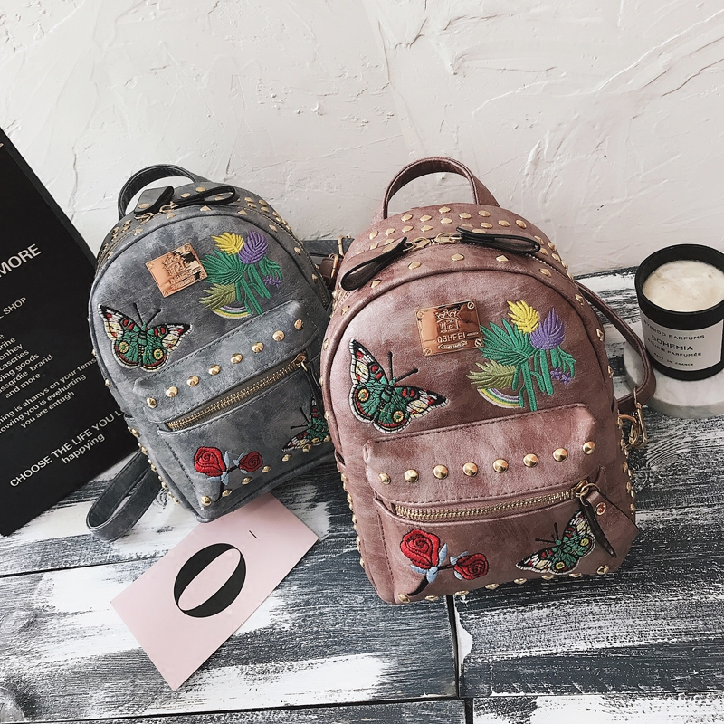 Korean version of the tide 2018 new retro embroidery rivets backpack casual wild multi-purpose small bag 28