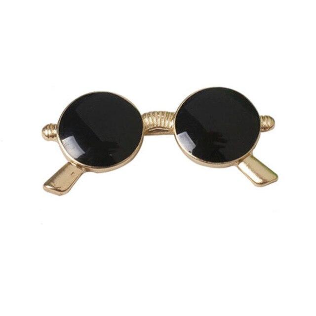 Модная брошка черные очки