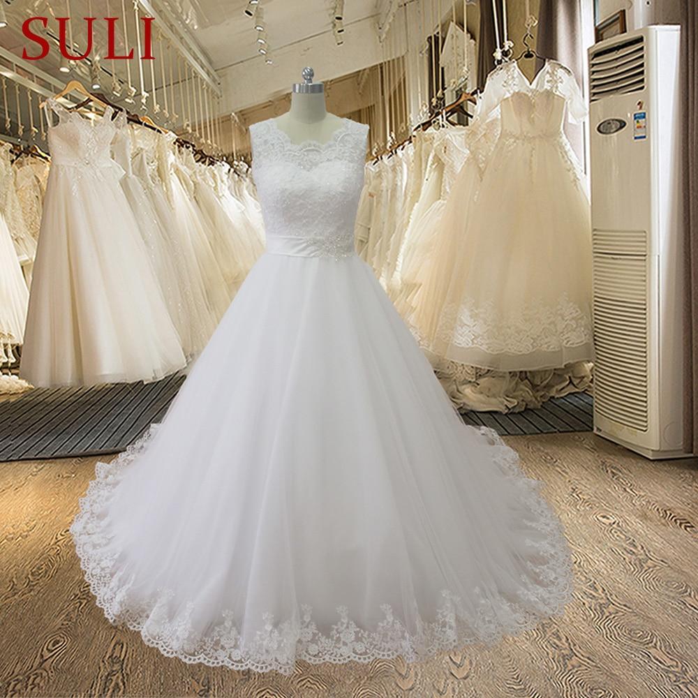 SL-02002 Skromna prawdziwa próbka koronkowa suknia ślubna z aplikacją