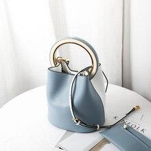 Upgraded version of the ring bucket bag women's Korean version of the leather female bag hit color hand shoulder bag