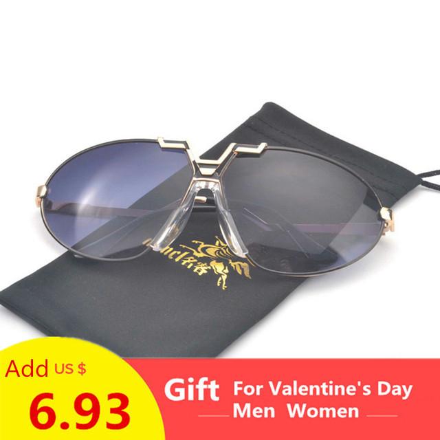 Gold trim tinted sunglasses