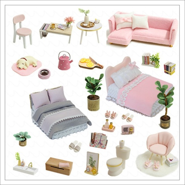 some of the contents items of the pink dolls house. dog, sofa, beds, tables and chairs