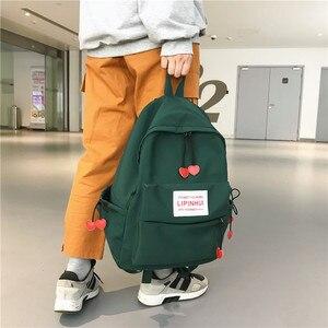 Image 1 - DCIMOR New Waterproof Nylon Backpack for women Heart Drawstring Travel Bag Teenage Girls Schoolbag Women backpack Preppy Mochila