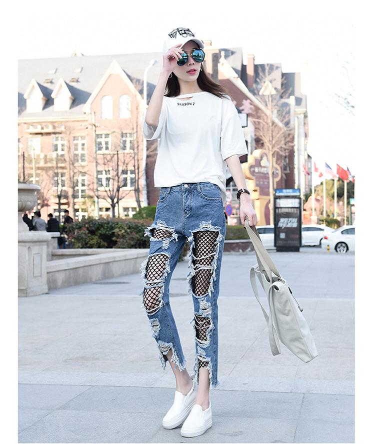 Sinised rebitud teksased naistele