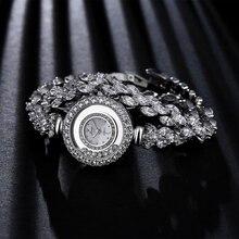 Mujeres de lujo circón relojes xinge famosas mujeres de la marca de pulsera de moda reloj de las mujeres vestido de cristal de cuarzo relojes de regalo de navidad