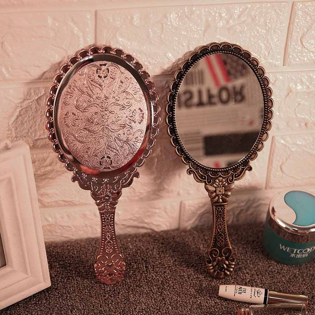 ヴィンテージ手すり化粧鏡ピンク打ち出し花オーバルラウンド化粧品ハンドヘルドミラーハンドルと女性のための美容ドレッサー