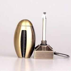 Image 1 - La coquille portative de démarreur de feu de silex correspond à la trousse dallumeur doutil de survie en forme de bouteille pour lextérieur sans huile