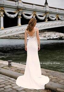 Image 5 - Profundo decote em v corpete duplo em camadas sereia vestido de casamento com trem destacável ilusão tatuagem estilo voltar vestido de noiva