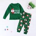 2 unids/set Nuevos niños niños y niñas pijamas de Navidad traje de santa prints pijamas niños pijamas set de manga larga tops + pantalones ropa