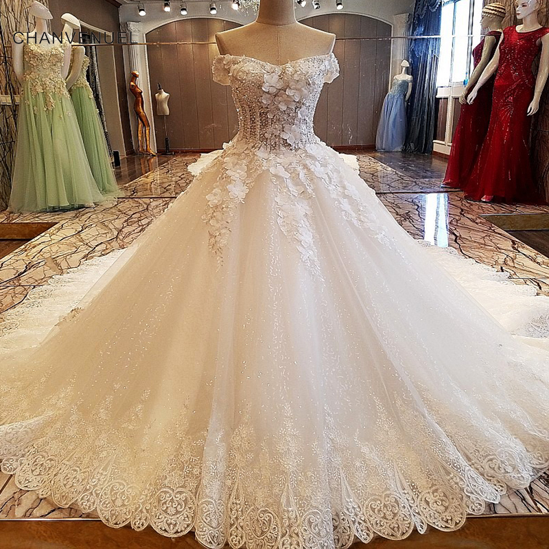 6120b766fb631 US $394.73 49% OFF|LS00094 Luxury bridal gown off the shoulder beading 3D  flowers ball gown lace wedding dress vestidos de noivas real photos 2018-in  ...