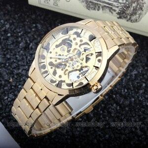 Image 2 - Montre bracelet à vent automatique, Style luxueux, unisexe, en acier inoxydable, squelette, cadeau horaire, M103, pour hommes et femmes