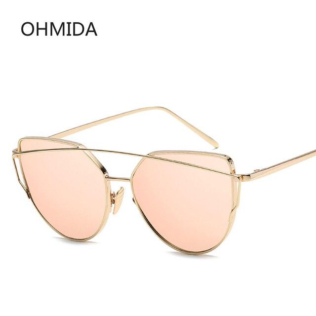 bcafad5587 Nueva moda de ojo de gato gafas de sol mujer marca diseñador de doble haz  lente