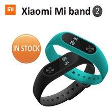 MiBand 2 EN STOCK! nuevo 2016 original xiaomi mi banda 2 inteligente de ritmo cardíaco de fitness pulsera oled 20 días de batería