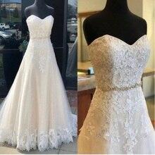 Sweetheart Neck suknie ślubne koronkowe aplikacje tiul bez rękawów suknie ślubne linia Backless Vestido De Noiva 2019