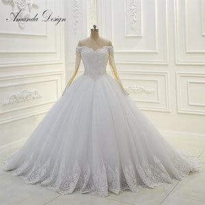 Image 1 - Amanda Design Off Shoulder Long Sleeve Lace Applique Pearls Ball Gown Wedding Dress