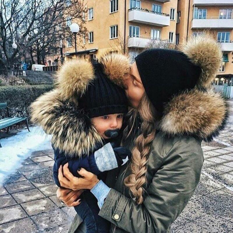 купить Fashion Parent-child Caps Cute Infant Baby Pompon Winter Hat Double Fur Ball Hat Mother Kids Warm Knitted Hat Newborn Beanie Cap по цене 130.56 рублей