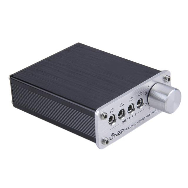 4 Entrada 4 Salida de Auriculares Auriculares Auriculares de 3.5mm MP3 Switch Conmutador de Señal de Audio Digital Multi-Canal de EE. UU. Plug negro Al Por Mayor