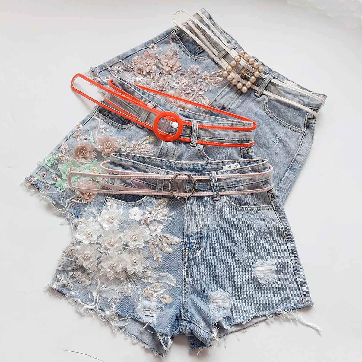 0384e28a7de Pantalones-vaqueros-pantalones-cortos-de-las-mujeres -amplia-pierna-pantalones-agujeros-perla-bordado-lentejuelas-3D-flor.jpg