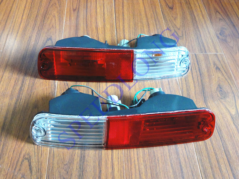 ФОТО 2 PCS/PAIR RH and LH Rear bumper lights lamps for Mitsubishi Pajero NP 2002-2006