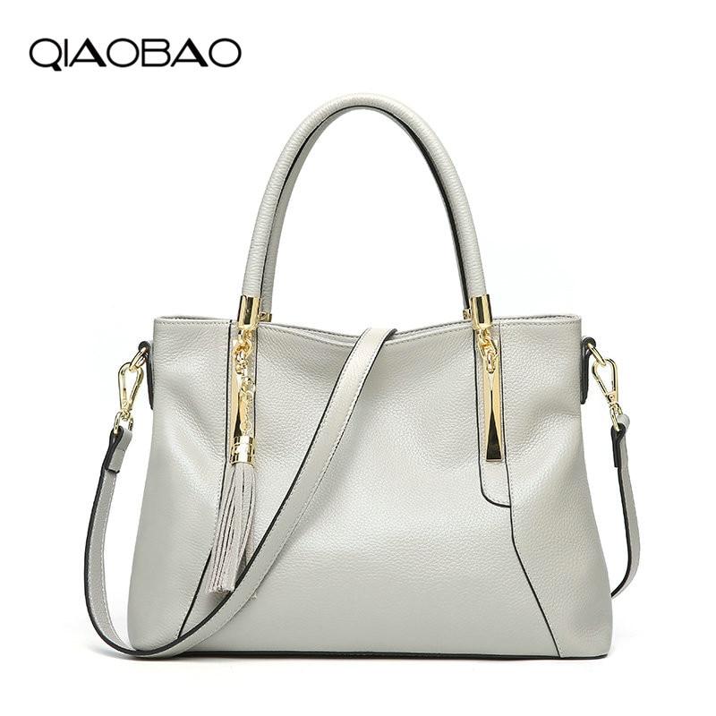 цена на QIAOBAO New Genuine Leather handbags fashion tassel top layer cowhide big bag shoulder Designer ladies bag