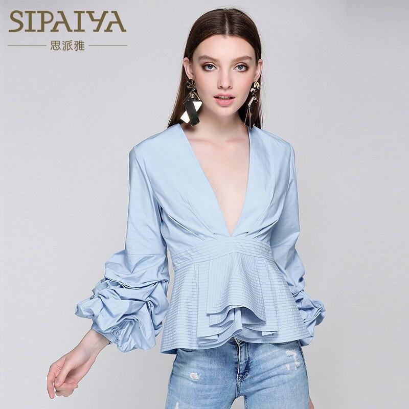 Nouvelle vente d'été européen et américain sexy col en V neuf points chemise couleur pure lotus feuille blouse fille