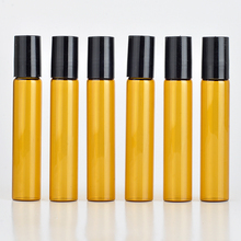 10 unids/lote rollo de 10 ML en portátil de vidrio ámbar botella de perfume recargable vacía caja de aceite esencial con tapa de plástico