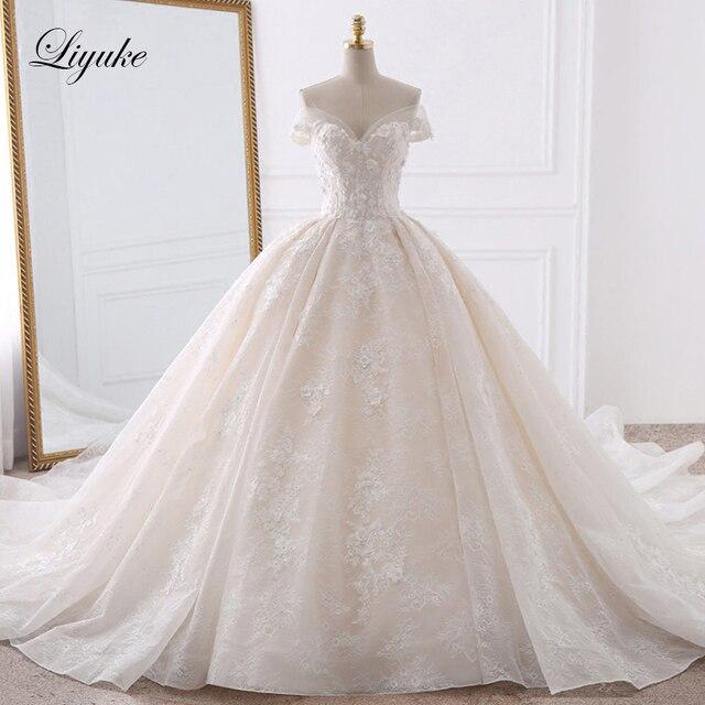 فاخر تول تطريز الحبيب الكرة ثوب الزفاف يزين الخرز اللؤلؤ قبالة الكتف فساتين زفاف خمر